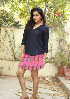 Rashmi Gautam looks sensational in loose Transparent Black Shirt and Pink Mini Skirt