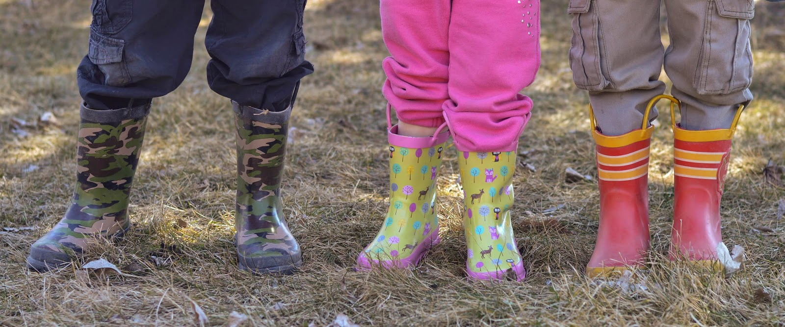 siblings in mud boots