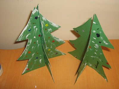 two finished standing paper christmas trees