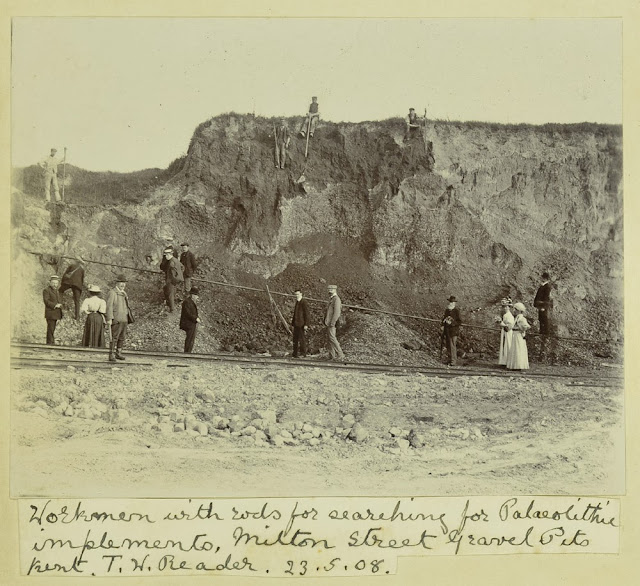 Caption: Workmen with rods for searching for Palaeolithic implements, Milton Street Gravel Pits, Kent. T.W. Reader 23.5.08. [1908]