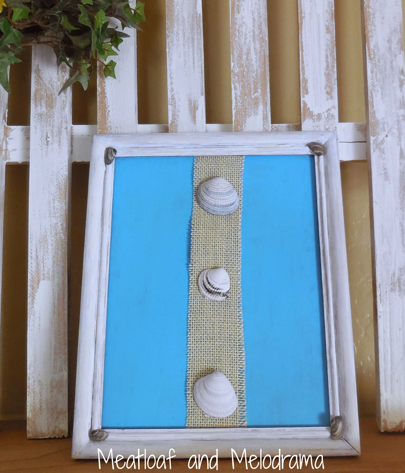 white picture frame with burlap and seashells