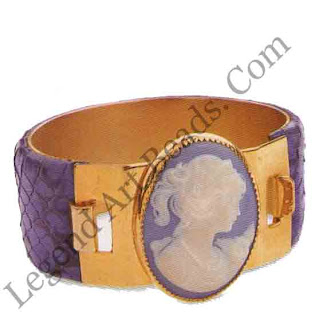 """This bracelet is an agglomeration of unusual periods. A porcelain """"cameo"""" on a highly polished cuff that itself is covered in lizard skin. It is flashy and mirrors the eighties """"go-get"""" attitude of conspicuous consumerism."""