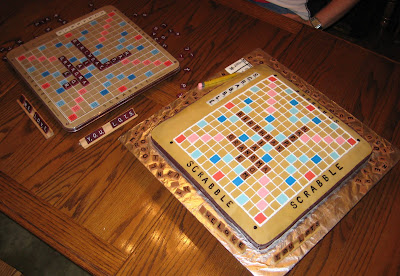 Real Scrabble Board next to Scrabble Board Cake 1