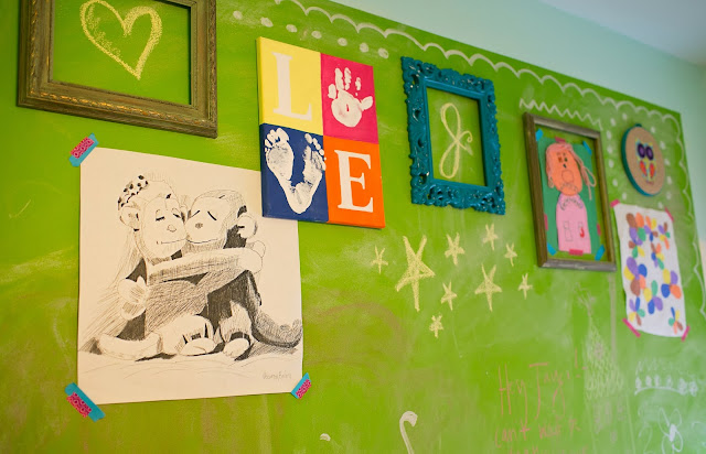 Bright and fun, colorful little girl's room on a budget. Chalkboard wall to display children's art.