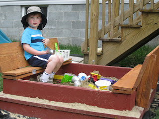 sandbox lid folds and turns into a bench
