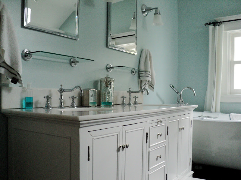 the double sink vanity provides storage i love how the title=
