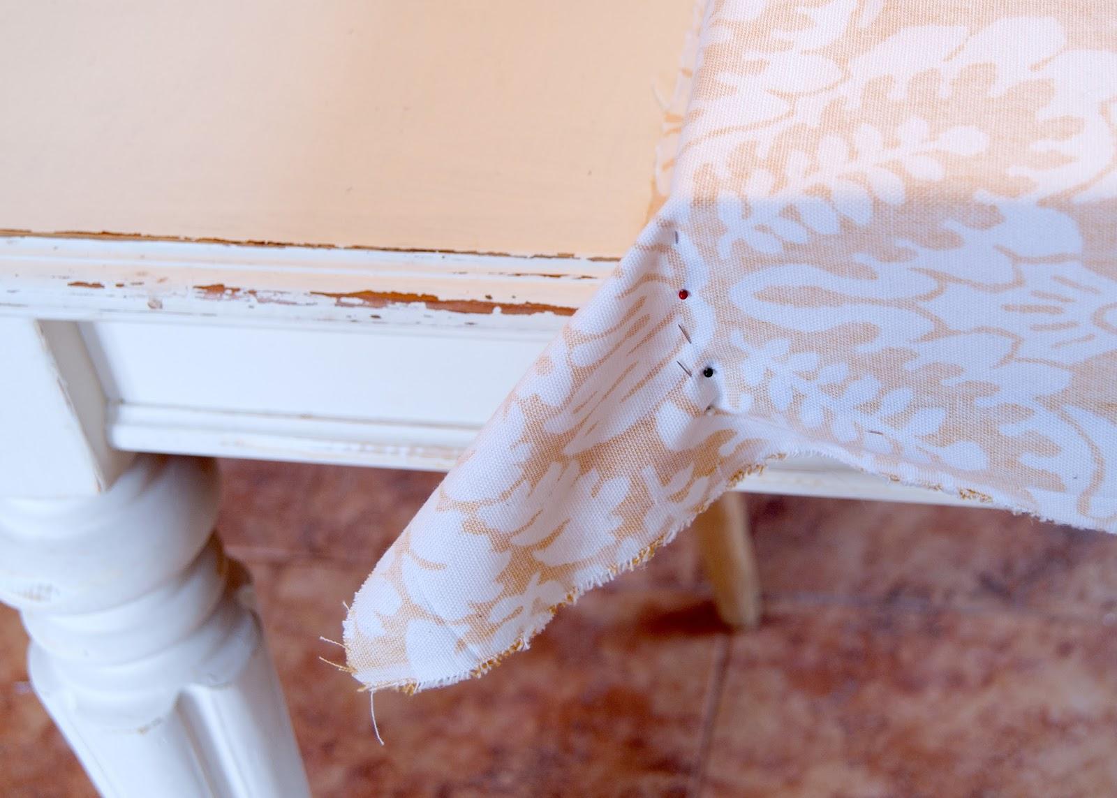 The pinned corner seam on an ottoman cushion
