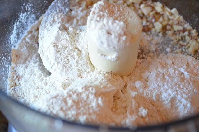 Key-Lime-Cheesecake-Bars-With-Almond-Cookie-Crust-Flour-Powdered-Sugar.jpg