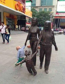 Cute Boy funny with statues