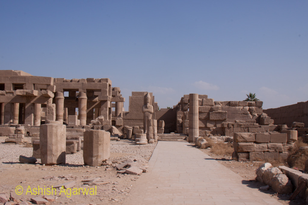 Path inside the Karnak temple, with fallen structures to the side