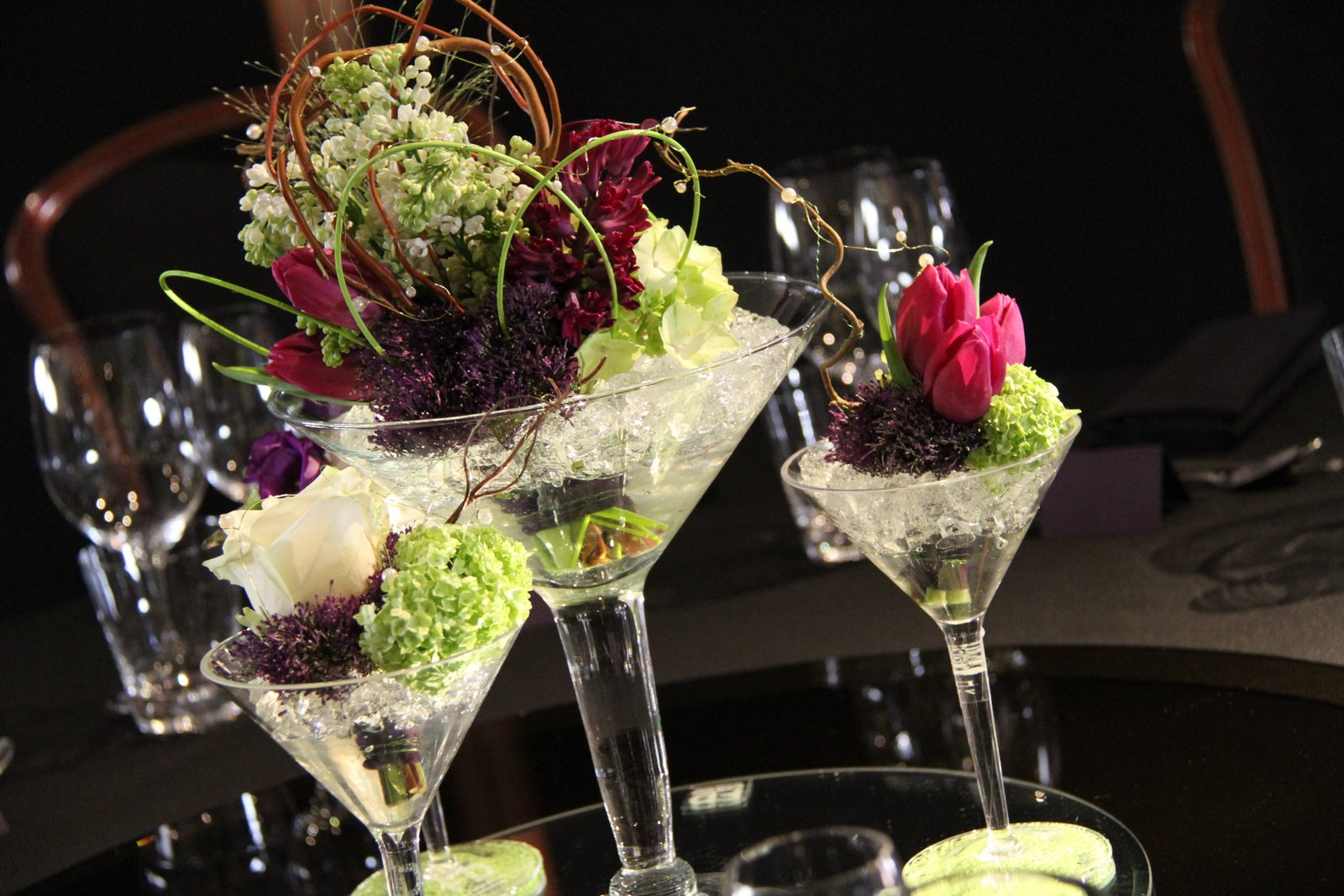 Flower design table centrepieces mini martini glasses table design a selection of oversized martini glasses in the centre of the table reviewsmspy