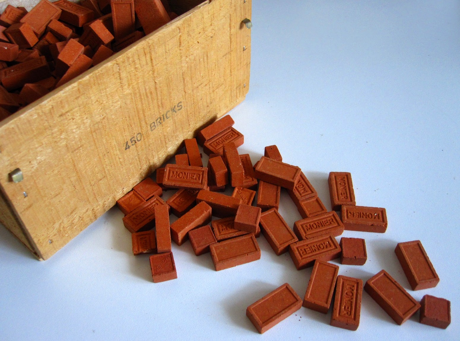 Wooden box of miniature bricks.