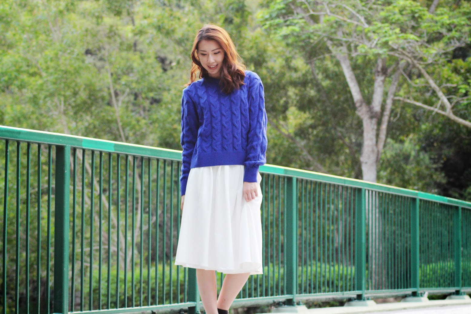 Styling blue sweater with flared white midi skirt