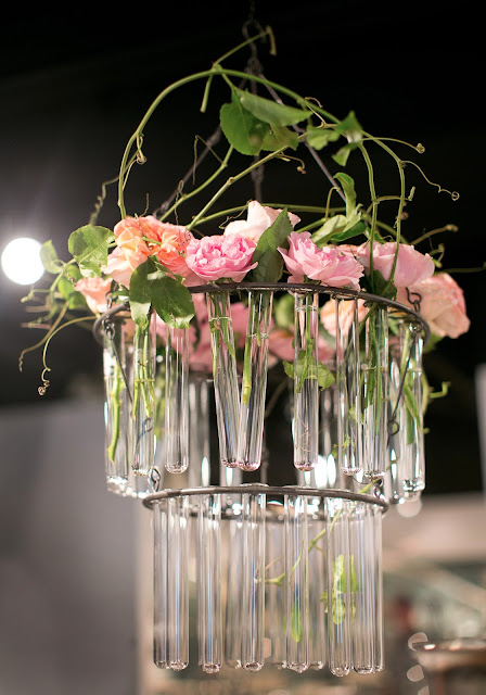 Roses in test tube chandelier