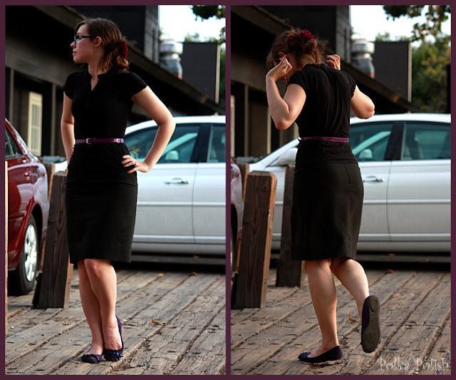 girl with glasses in black pencil skirt black shirt purple belt shoes flower