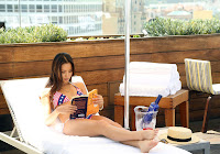 Jamie Chung reading a book in a bikini