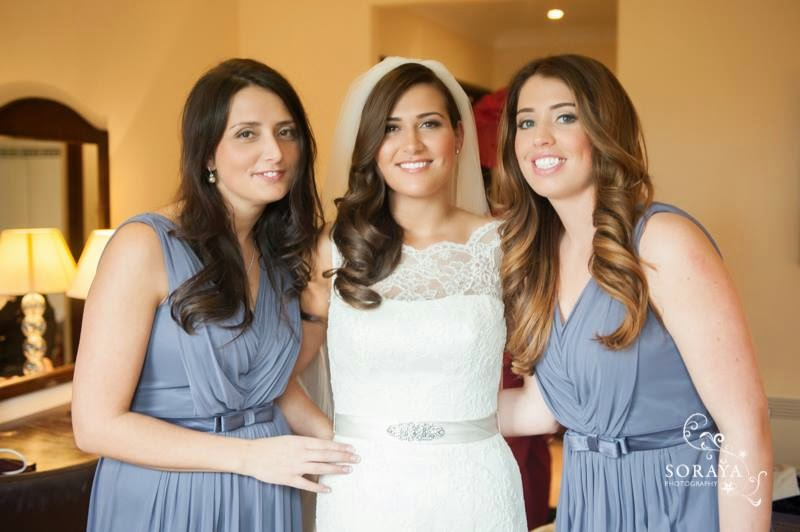 bride with her sisters all with loose soft waved hairstyles
