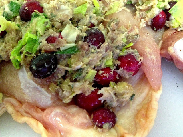 Cranberries soaked in port, leeks and sausage meat covering the chicken