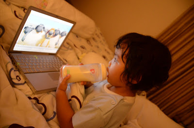 Kecil with her bottle watching Baa