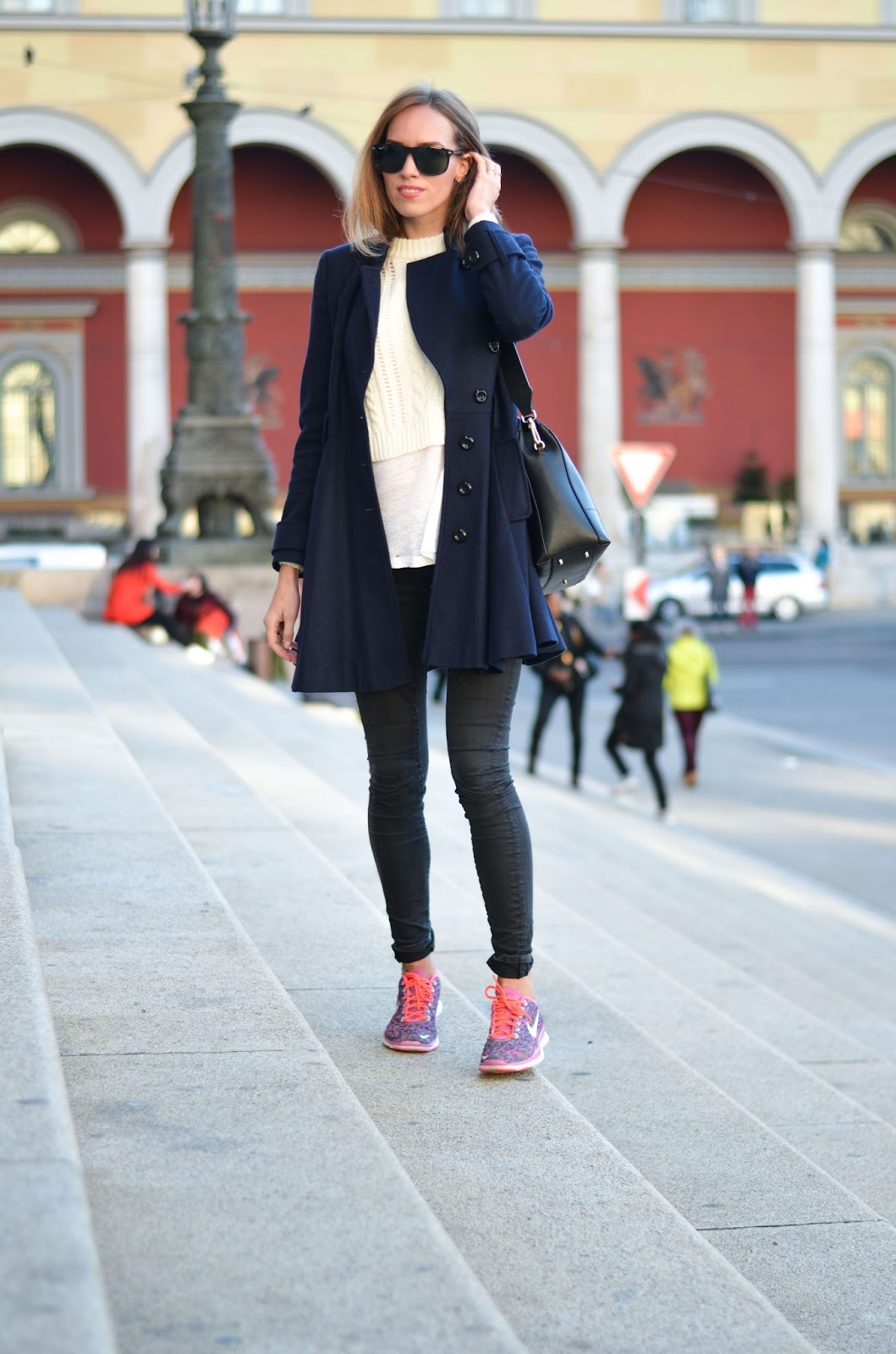 kristjaana mere winter fashion dark blue wool coat white t shirt black jeans pink trainers