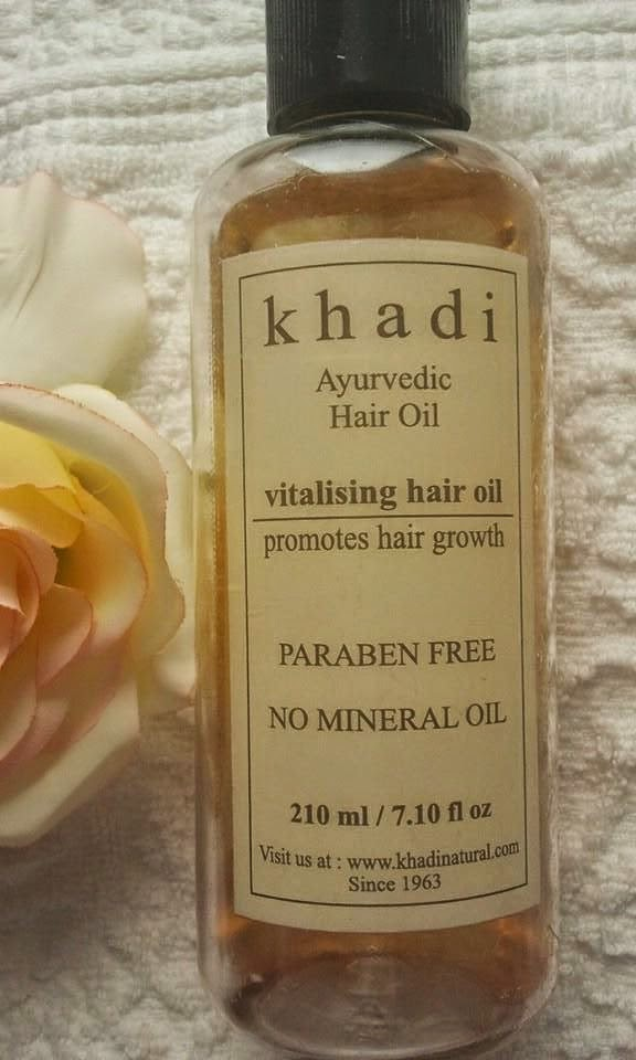 Khadi-Ayurvedic-Oil-vitalising-hair-oil-on-my-table-with-a-rose
