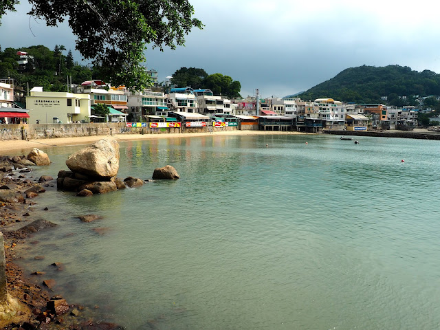 Houses of Yung Shue Wan by the sea and harbour, Lamma Island, Hong Kong