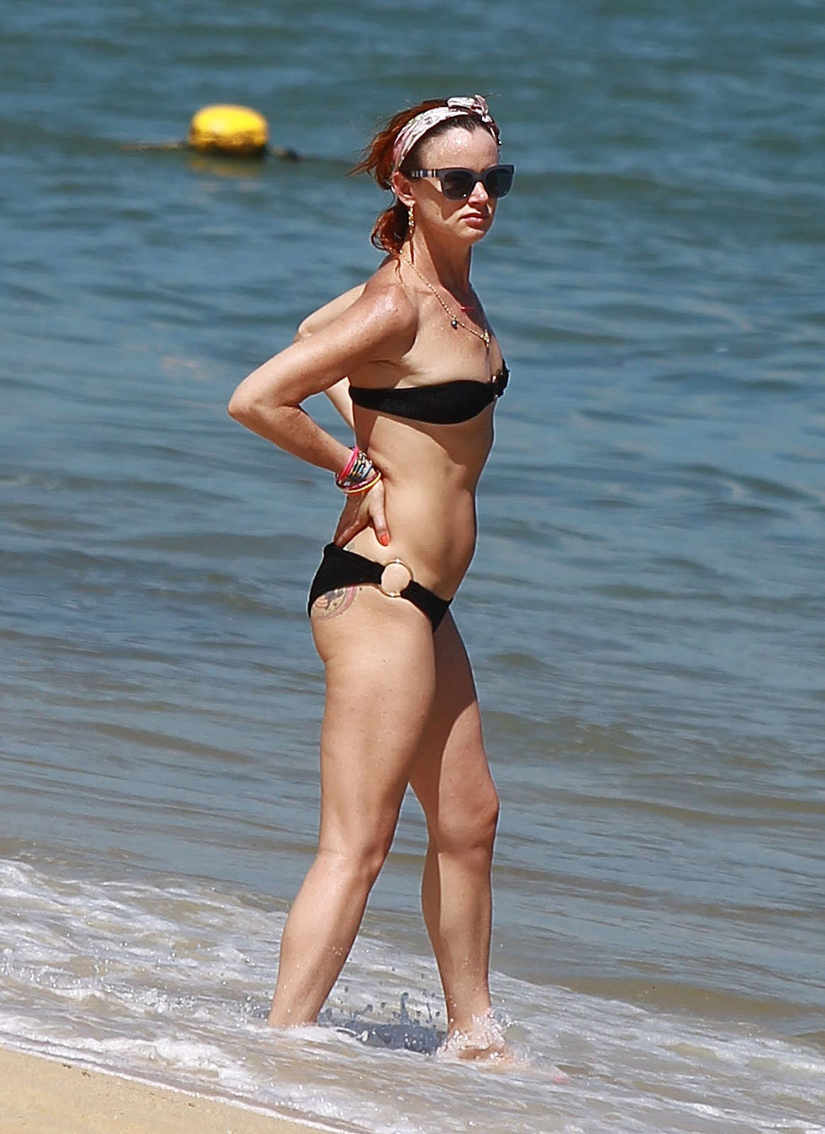 Actress Juliette Lewis seen in a black bikini on the beach in Mexico ...