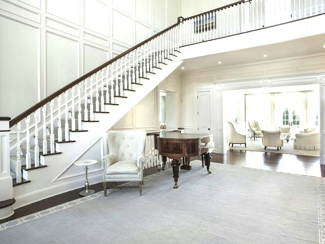 Entry hall in a Hamptons mansion Water Mill estate paneled wall