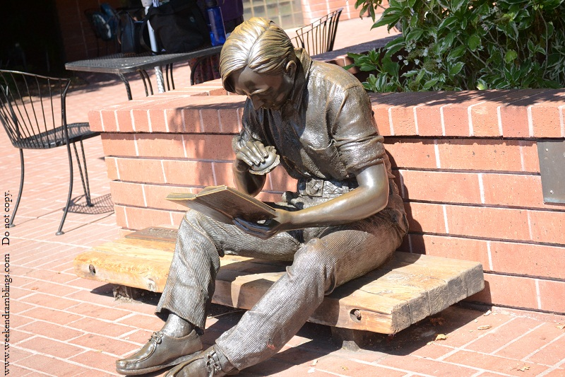 sunnyvale public library statue man reading book eating burger sculpture