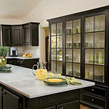 An all black kitchen with pops of color, think the glass cabinets are