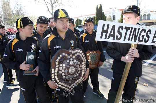 Defending champions: Holding the Ross Shield is Art Thompson, the only member of last year's team in this year's team - Members of the Hastings East Ross Shield rugby team, pictured with the Ross Shield they won last year, before the parade and official welcome in the Hastings CBD, on the first day of the annual Ross Shield rugby tournament being held at Lindisfarne College, Hastings. By tournament end on Sunday, Hastings East had to relinquish the Shield to Napier. photograph