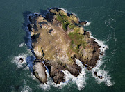Aerial photo of Grassholm Island taken in 2011. The gannetry is situated on . (aerial photo of grassholm island taken in )