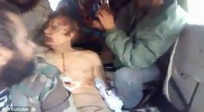 Jenazah Moammar Khadafi Dipermainkan Seperti Boneka