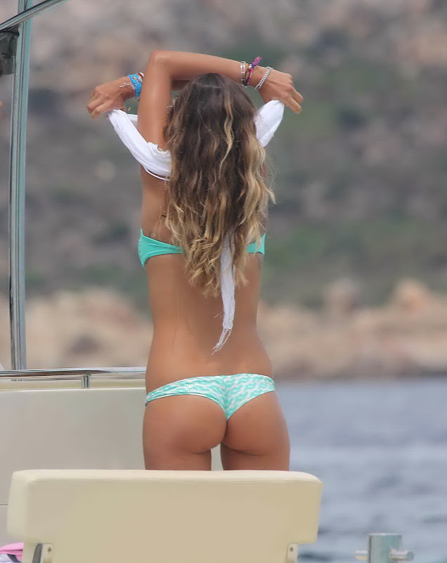 Melissa Satta taking off her shirt and revealing her great ass in a two piece swimsuit