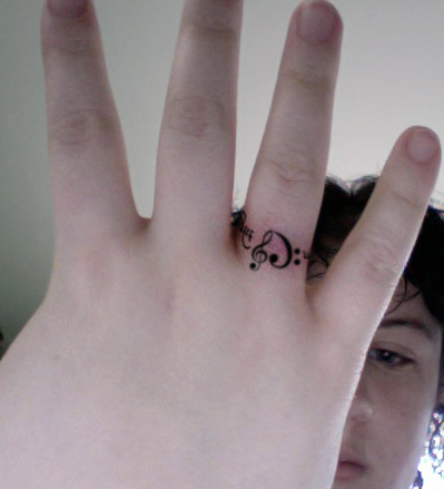Womens wedding ring tattoo
