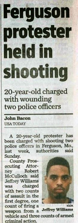 Ferguson protester held in shooting