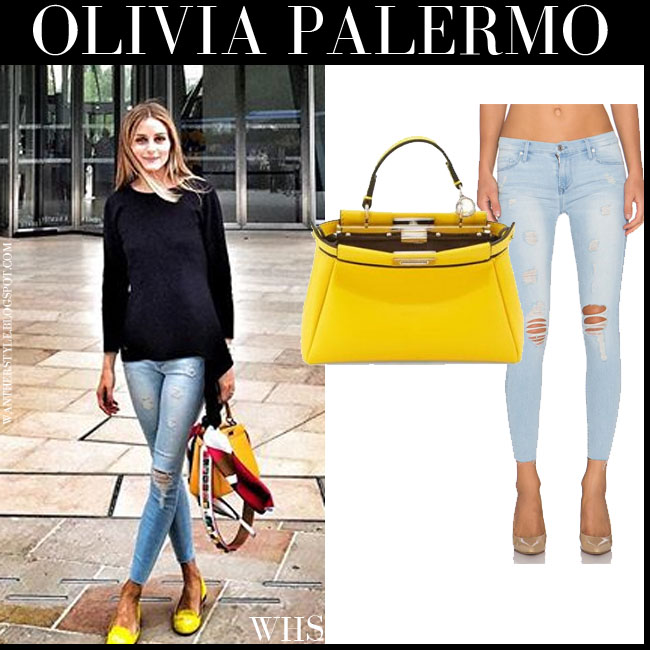 Olivia Palermo in light blue skinny distressed Black Orchid Noah jeans, black sweater, yellow SchoSchoes loafers with yellow Fendi bag what she wore july 8