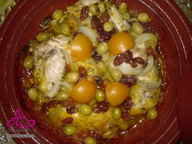 طاجين.الدجاج.بالزبيب.والبصل