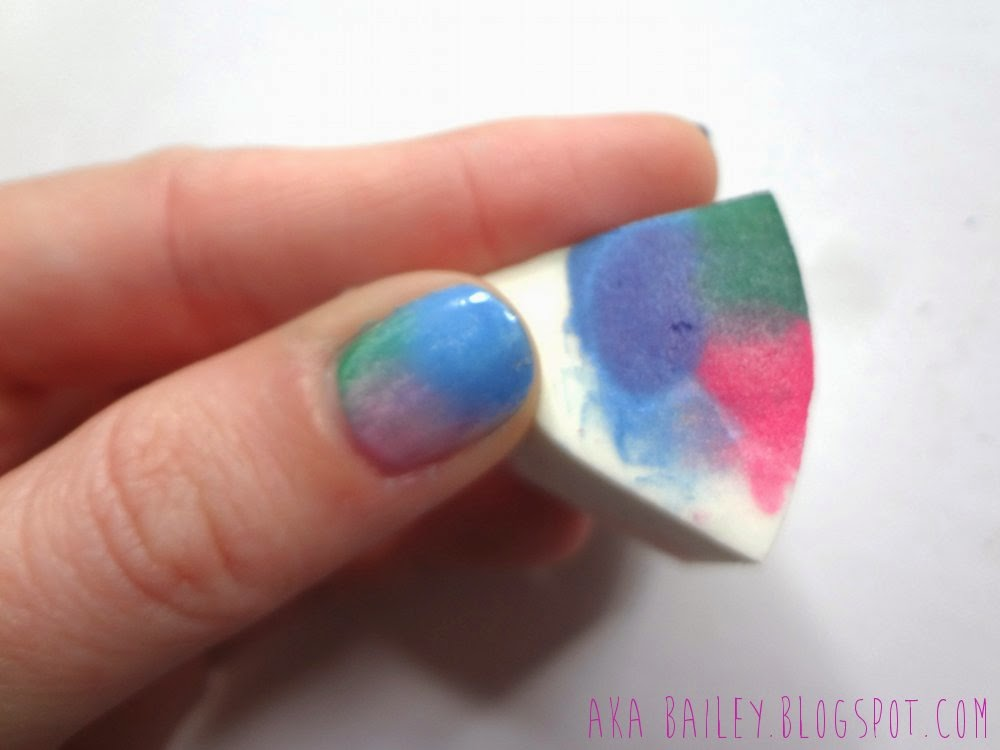 Use a makeup sponge to sponge on your nail polish design.