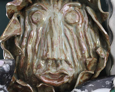 wood bark sculpted face in clay glazed