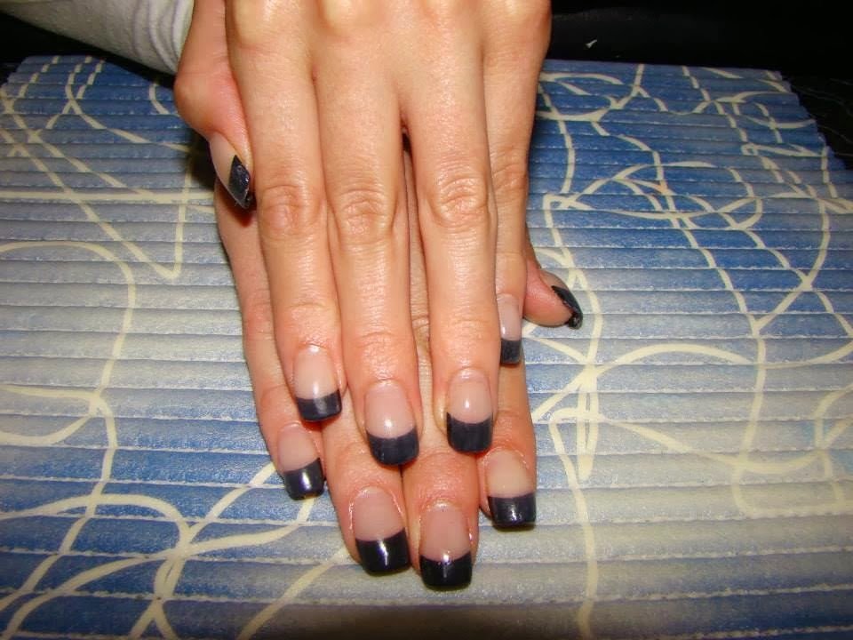Acrylic back-fill black French tips by applying a natural pink body cover LED polish 3 in 1 which is base-coat, color and topcoat
