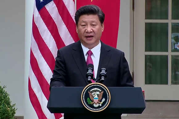 Chinese President Xi Jinping addresses a news conference at The White House in Washington, D.C.