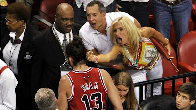 Obnoxious woman and man at Heat versus Bulls game captured for eternity giving Joakim Noah a Miami farewell