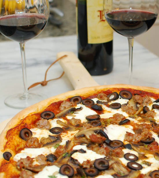 http://www.formerchef.com/2010/04/26/cooking-your-own-fast-food-pizza-with-fresh-sausage-mushrooms-and-olives/