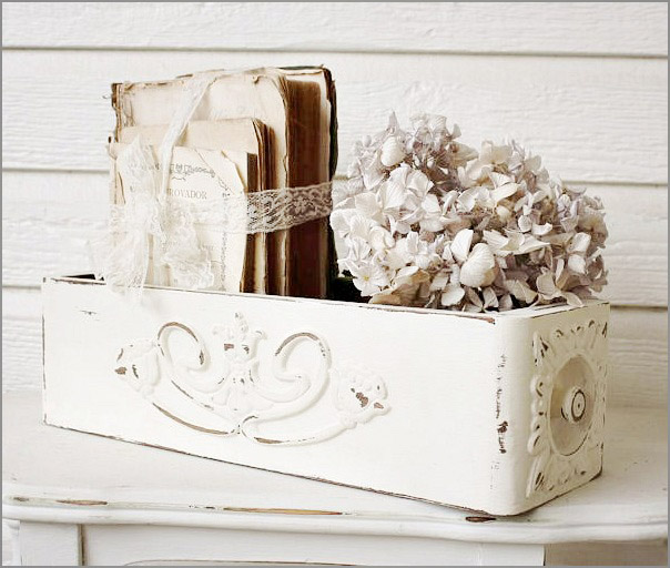 This renovated drawer with rustic white paint adds a vintage touch to the table.