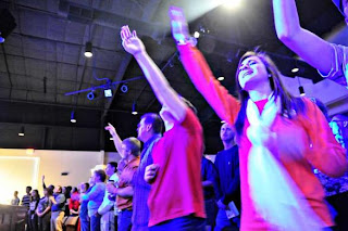 hands raised, praise band, non-denominational, christian, worship