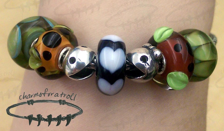 Trollbeads Aqua Edge Petals, Orange Pod, Ghost Fighter, White Heart, Ms. Ghost Fighter, Red Pod, Aqua Edge Pumpkin