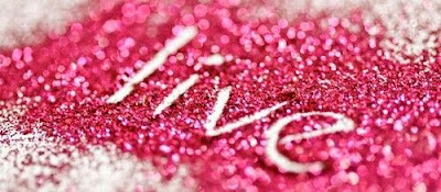 """Live"" Picture of the word 'live' written in a bunch of pink glitter."