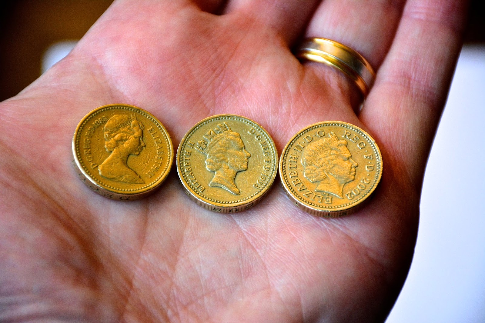 Second, third, and fourth coin portraits of Queen Elizabeth II