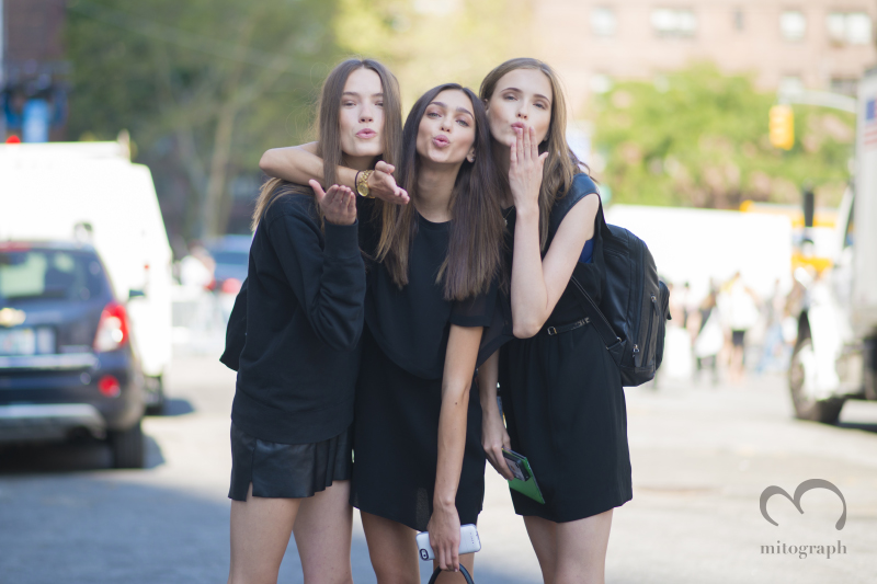 Model Taya Ermoshkina and Zhenya Katava and Jane Grybennikova blow kiss at New York Fashion Week 2015 Spring Summer NYFW